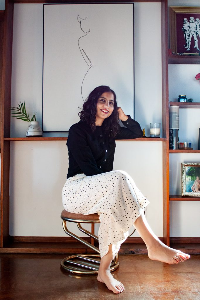 business casual outfit idea black blouse and white dot pants