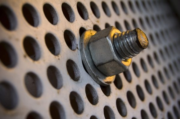 Industrial Photography: Free Stock Photo Downloads. A close-up image of a bolt on a large, industrial screw.
