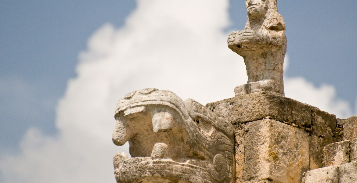 Stone carvings stand out against gathering clouds near the Temple of the Warriors at the Yucatán Peninsula's Mayan ruins of Chichén Itzá.