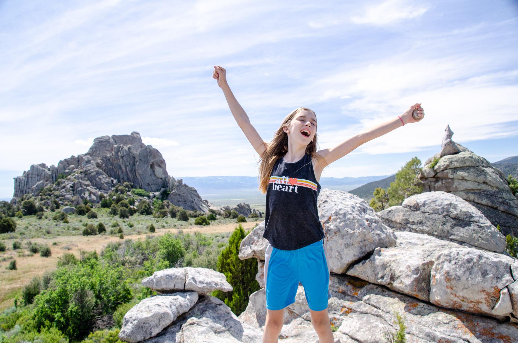 Explore the Best Hiking in Castle Rocks State Park Idaho. A young girl stands atop massive boulders inside the Castle Rocks State Park Idaho complex.