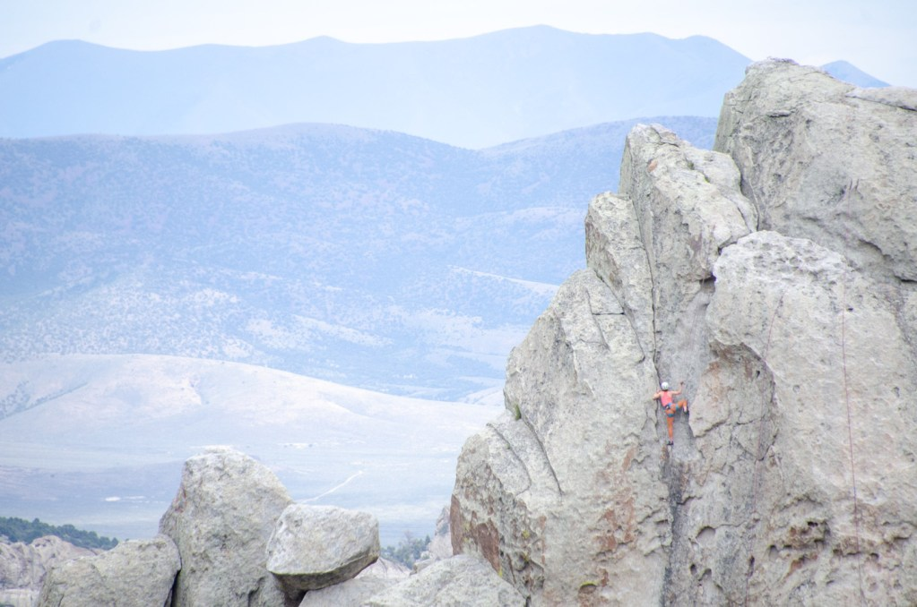 City of Rocks - Climbing Hiking Camping. A climber ascends a vertical rock face in Idaho's City of Rocks National Reserve.