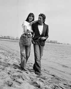 1974, Cannes, France --- French singer and songwriter Serge Gainsbourg and his partner, British actress and singer Jane Birkin, attend the 1974 Cannes Film Festival. --- Image by © Mirkine/Sygma/Corbis