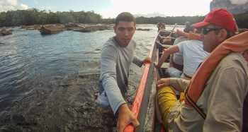 even our guide had to hop into the water to guide the boat through some shallow water