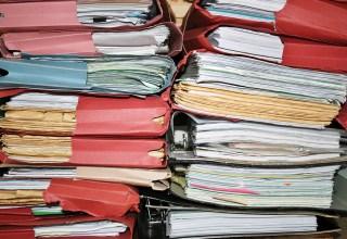 bigstock Twin Stacks Of Files 1348584 - Timeline: Missouri's Medical Marijuana Program - Greenway - Greenway