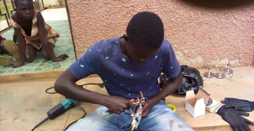 Lawrence Okettayot is the engineer that has been pushing the Sparky Dryer project. Photo - YouTube