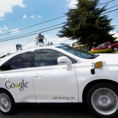 Google's self-driving Lexus drives along during a demonstration of artificial intelligence. Photo - AP - Tony Avelar
