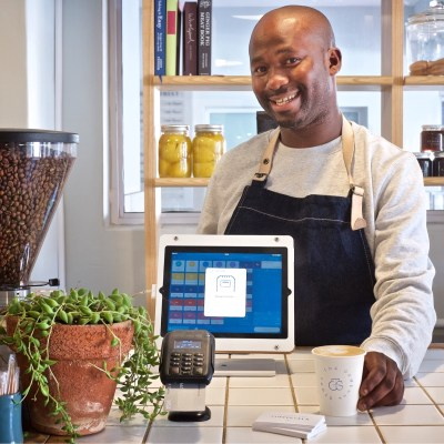A small business owner uses a Yoco card reader product. Photo - Yoco