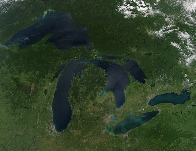 an aerial view of the two peninsulas of Michigan in America showing the great lakes surrounding them
