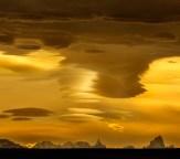 Panorama of Mt Fitz Roy and Cerro Torre under lenticular clouds at sunset - Mirador Julio Heredia