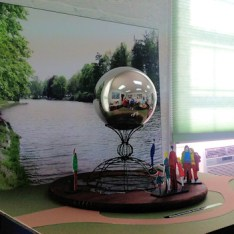 A mockup of a proposed 8ft stainless steel globe sculpture titled One World. The design was originally envisioned for the north side of the pedestrian bridge