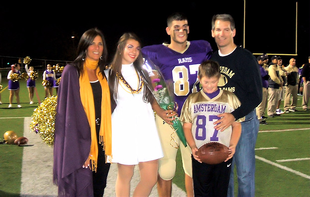 Senior Marcus Pritchard with sister Guiliana and parents. Photo by Scott Mulford.