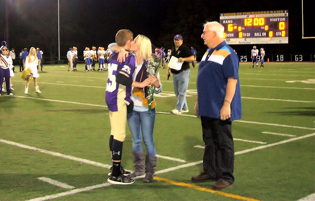 Senior Tyler Cole and his parents. Photo by Scott Mulford.