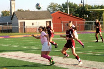 Madison Healy hustling for a pass