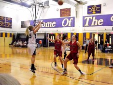 Caitlin Gannon hits a three point shot