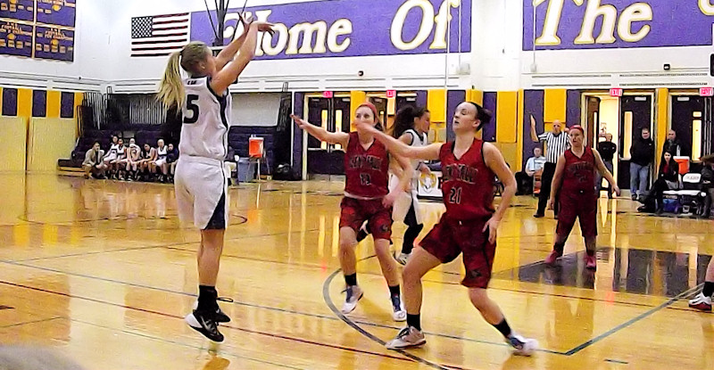 Caitlin Gannon shoots a three pointer. Photo by Scott Mulford.