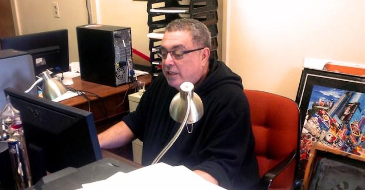 John Duchessi working at his Bridge Street office. Photo by Tim Becker.