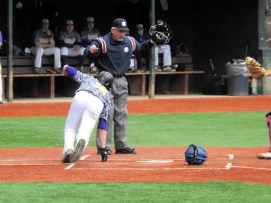 Dale Stanavich sliding in safe at home