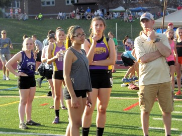 Coach Palczak with Giuliana Pritchard and Emma Gomez watching Santana's run