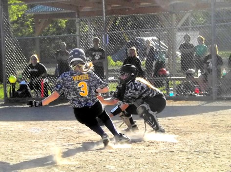 Natalie Vogel sliding in safe at home