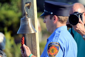 Andy Iannotti of the Amsterdam Fire Department rings a traditional fire bell signal 5-5-5-5, indicating death in the line-of-duty. Photo by Robert Fiore, used by permission.