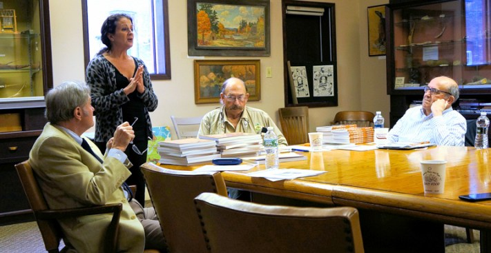 Ann Peconie (standing), director of the Walter Elwood Museum