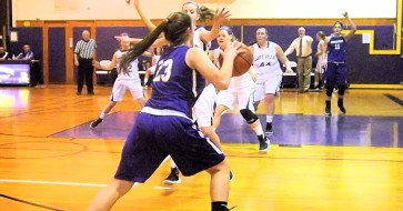 Giuliana Pritchard drives past an opponent