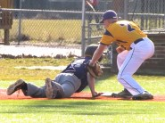 Connor Verde putting a tag on a Ballston Spa runner at first