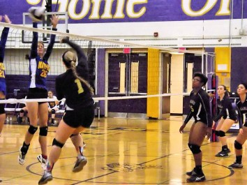 Maria Lomanto hits over a block