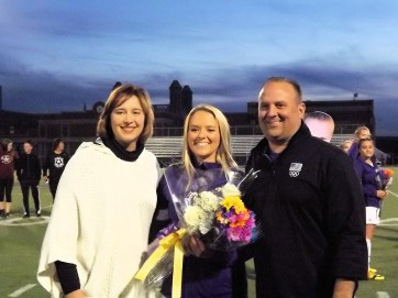 Martina Hughes with her parents