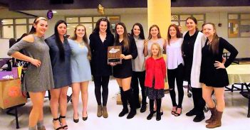 The varsity team along with Abby Grant and the Section 2 Class A runner up plaque