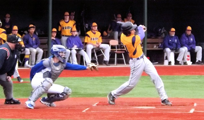 Owen Devine connects for a hit