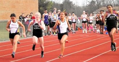 Brenda Santana (center) leads in the 100 meter