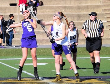 Alyssa Kuchis (#4) takes the face off for AHS