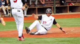 Jake Mueller slides in safe