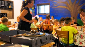 Kids listen to jazz music played through a hand-cranked WW2 era phonograph