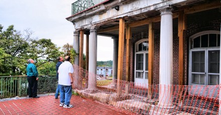 Council members Jim Martuscello, Chad Majewski, Rodney Wojnar, inspect the southeast portico at City Hall