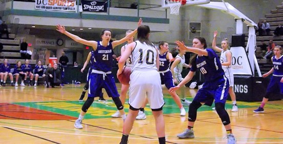 Antonia May (#21), and Stanavich (#10) defend Stephanie Jankovic at the Class A final