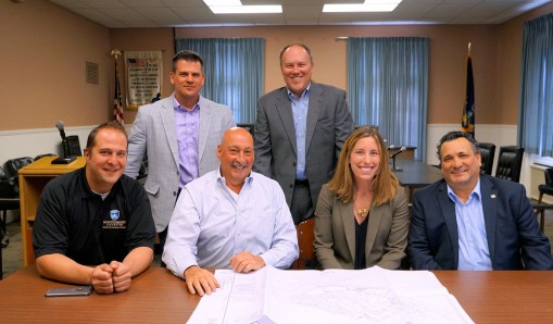 Front: Matt Ossenfort, Montgomery County executive, Luigi Lanzi, Lanzi's co-owner, Stacy Kaplowitz, KCG Development Vice President for Mid-Atlantic. Back row: Ken Rose, MCBDC CEO, Bill Teator, DEW Ventures, LLC.