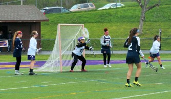 Paige Bertuch, #17 defending the goal