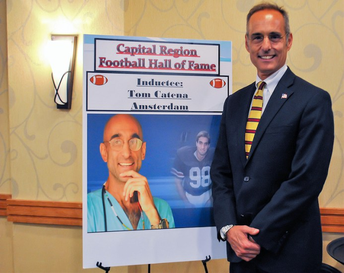 Felix Catena accepts inductee award on behalf of his brother Tom Catena