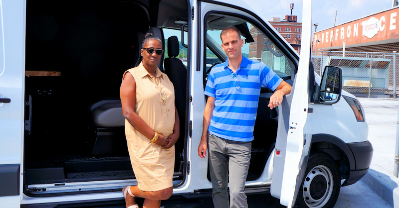 Nydia Hill, Chad Putman of New Choices Recovery Center with mobile office