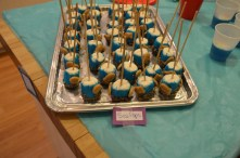 Sea Pops - Marshmallows with blue frosting, crushed pecan bottoms and cupcake goldfish crackers