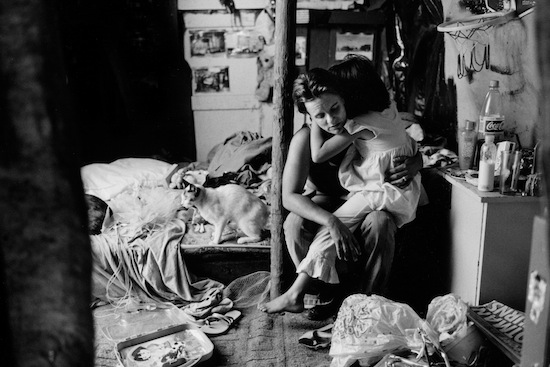 """Ian Martin: Hidden Minority: South Africa's White Poor- Getty Images - Shana comforts her daughter Maxine in their shanty. Shana is also addicted to """"tik,"""" South African slang for methamphetamine. (These are not their real names.)"""