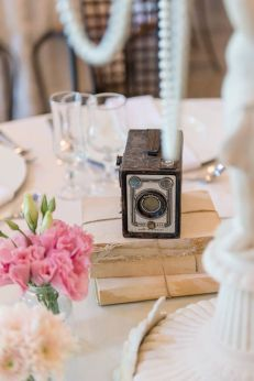 Add vintage flair to your centerpiece with a vintage camera. Pic by Lightburst Photography