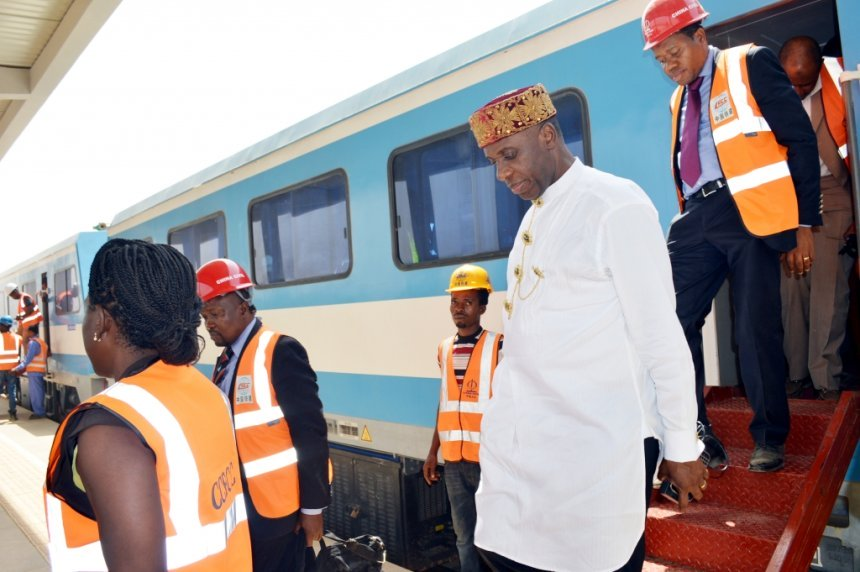 Minister of Transportation, Rotimi Amaechi coming out of a train