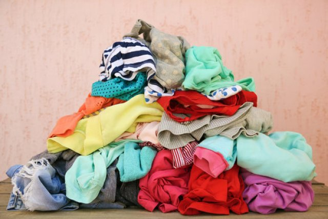 piles of clothes - downsizing in 5 simple steps