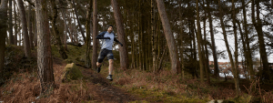 Running in the woods in Mokimor t-shirt