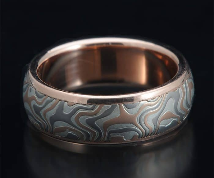 custom red gold channel ring
