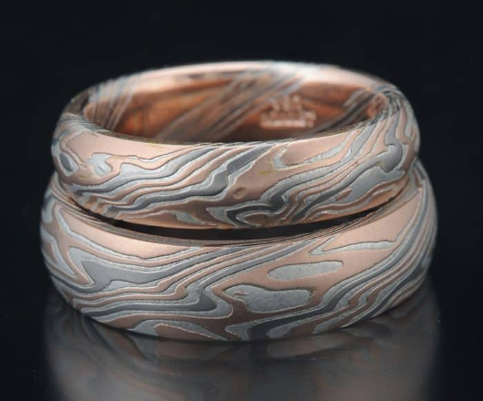 matching etched red gold wedding bands