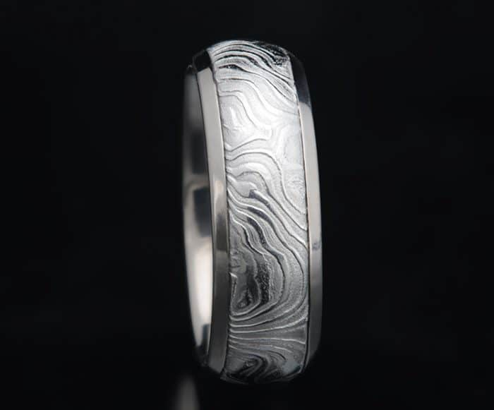 Damascus and titanium wedding ring